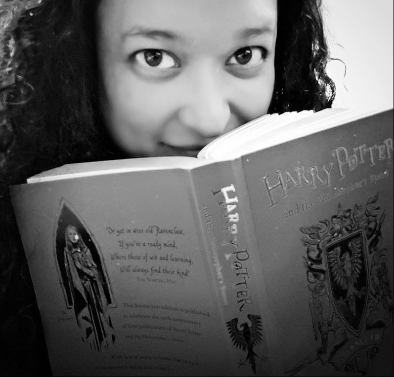 Photo of Veronica Leonard reading Harry Potter and the Philosopher's Stone