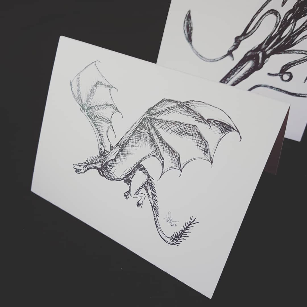 notecards with sketch prints of a wyvern and a kraken